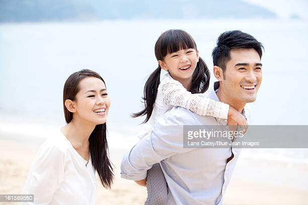 Happy young family enjoying the beautiful beach of Repulse Bay, Hong Kong