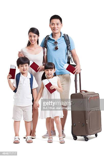 Happy young family going for vacation