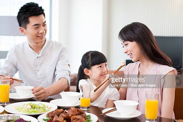 Happy young family having lunch