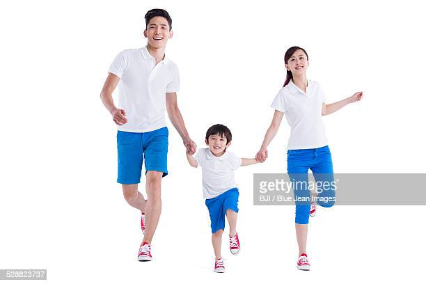 Happy young family holding hands