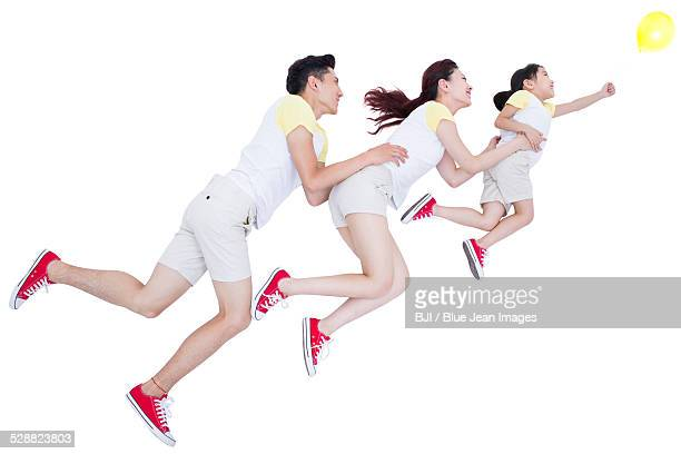Happy young family in flying position