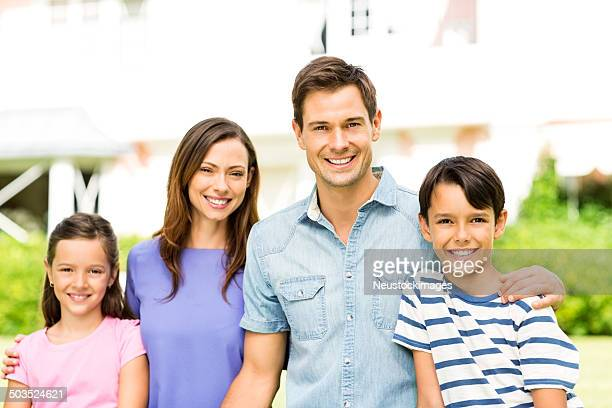 Happy Young Family In Garden