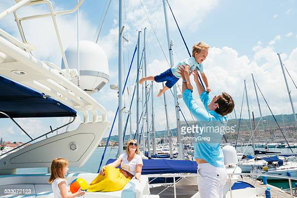 Happy young family on motor yacht