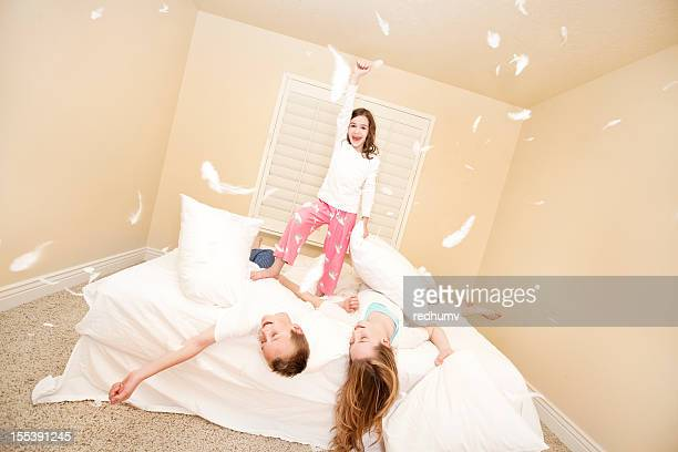 Happy Young Family Pillow Fight