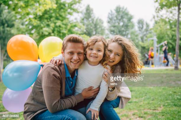 Happy young family portrait outdoors