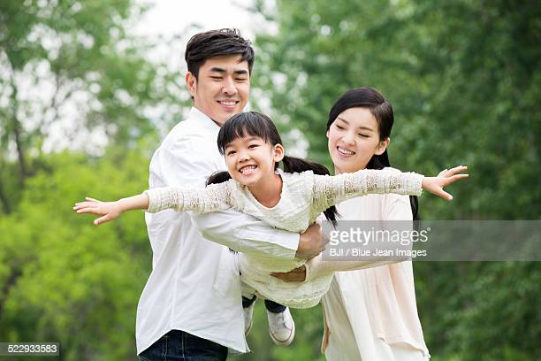 Happy young family with one child