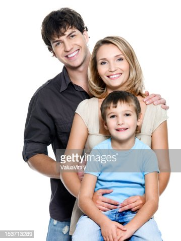 Happy young family with pretty child : Stock Photo