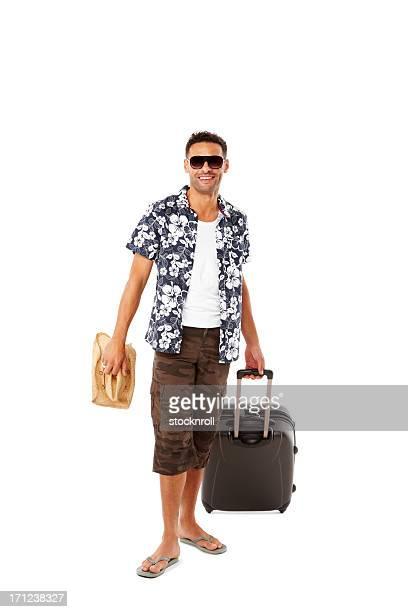 Glückliche junge Mann geht auf Urlaub