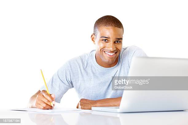 Happy young guy using the internet for research