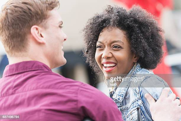 Happy young interracial couple outdoors