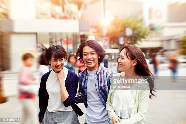 Happy young japanese friends fun outdoors, Tokyo.