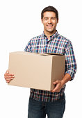 Happy Young Man Carrying a Cardboard Box - Isolated