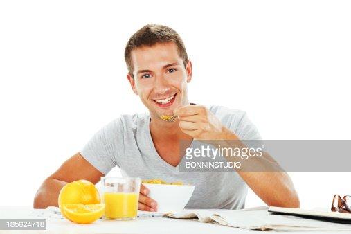 Feliz joven con energía de desayuno : Foto de stock