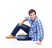 """""""happy young man on the floor, isolated on white background"""""""