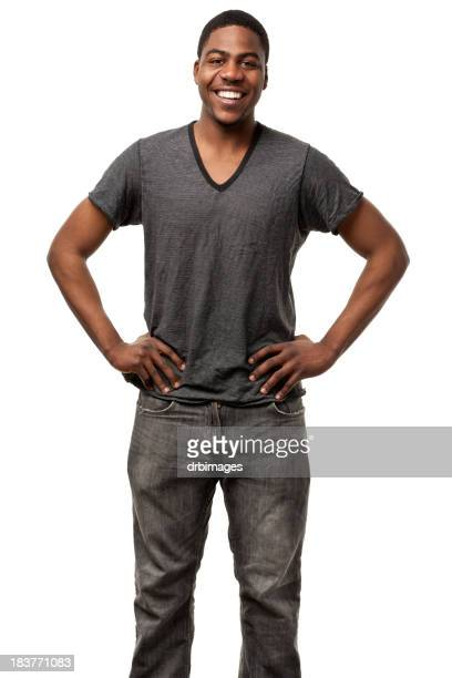 Happy Young Man Standing With Hands On Hips