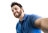 Happy young man taking a selfie photo on white background