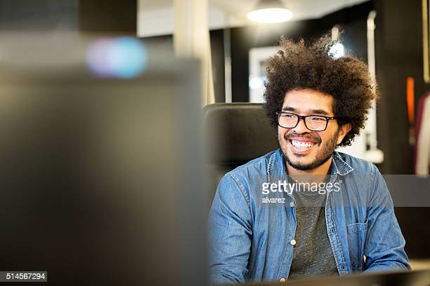 Happy young man working at startup