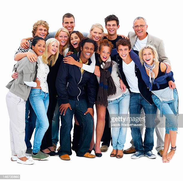 Happy young men and women standing against white background
