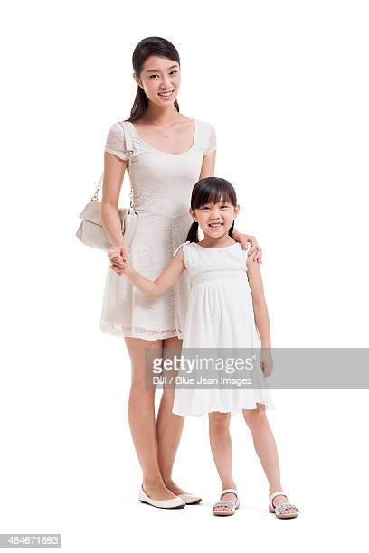 Happy young mother and daughter