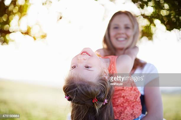 Happy young mother with little girl having fun