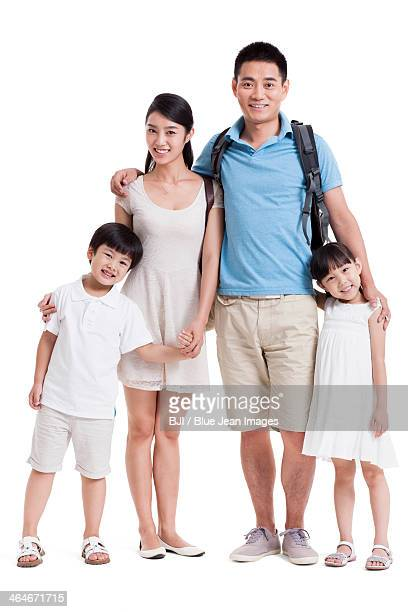 Happy young parents and two children