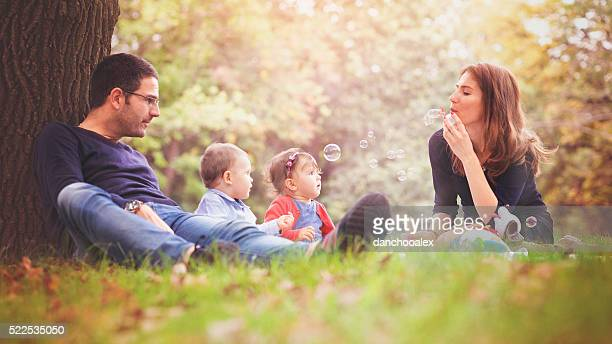 Happy young parents with their children in the park