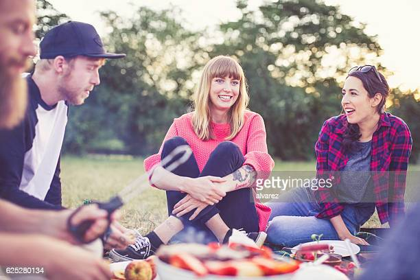 Happy young people having a picnic