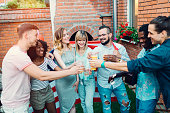 Happy Young People Toasting At Backyard Party.