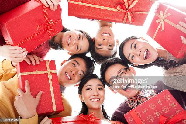 Happy young people with gifts in Chinese New Year