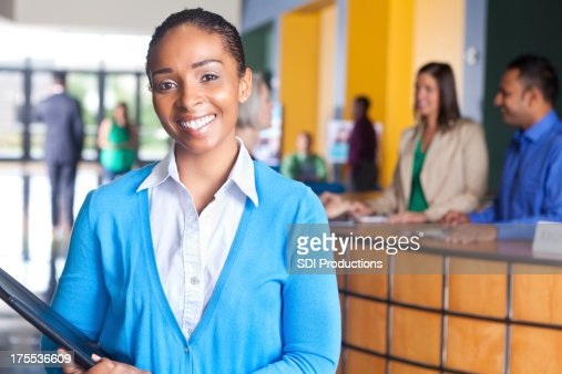 Happy young professional businesswoman smiling at job fair event