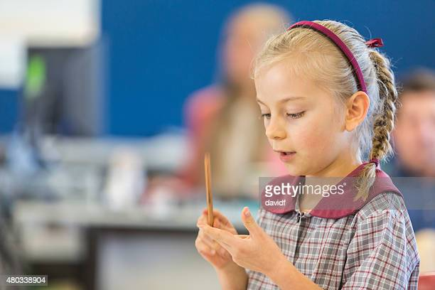 Happy Young School Girl Counting on Her Fingers