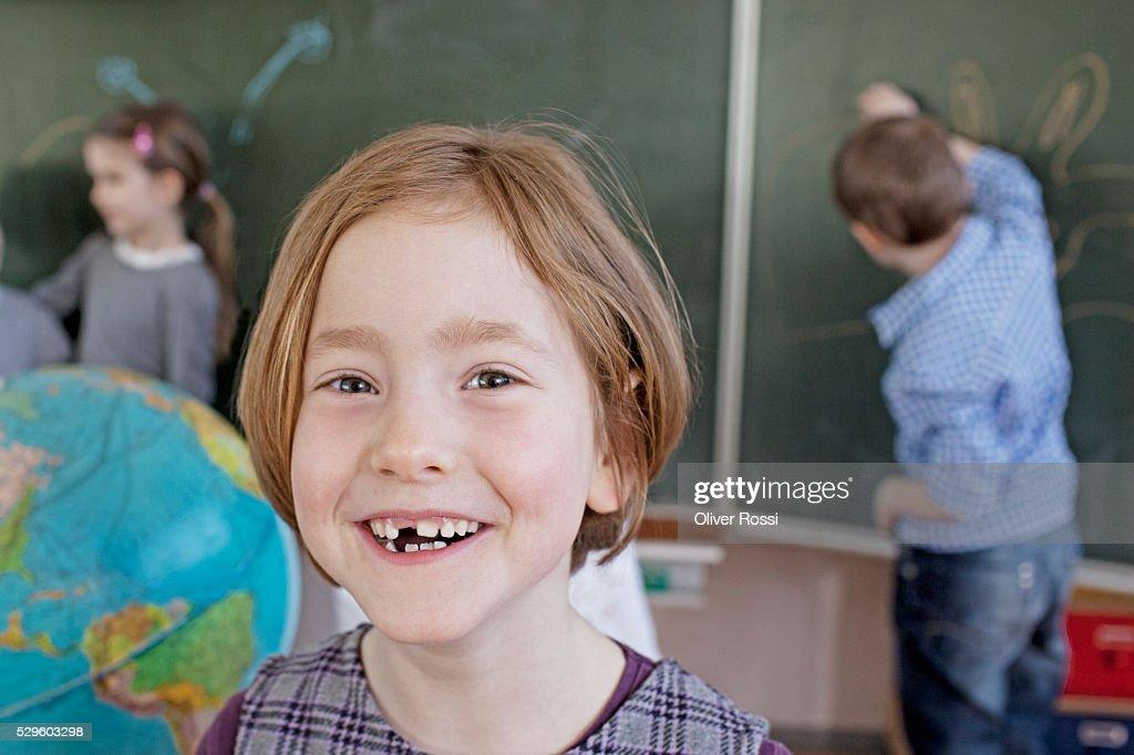 Happy young school girl (6-7) : ストックフォト