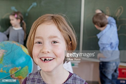 Happy young school girl (6-7) : Stock Photo