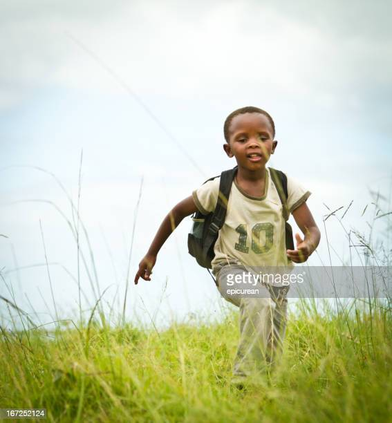 Happy Young South African Boy running to School