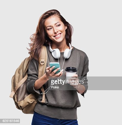 Happy young student girl using smart phone : Photo