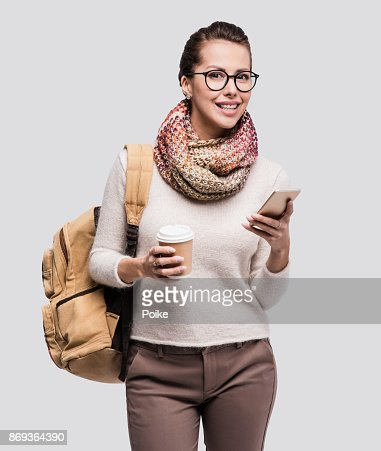 Happy young student girl using smart phone : Stock Photo