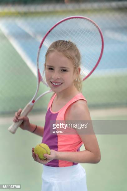 Happy young tennis player