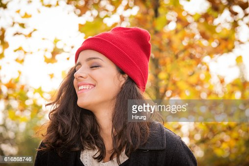 Happy young woman at autumn : Stock Photo