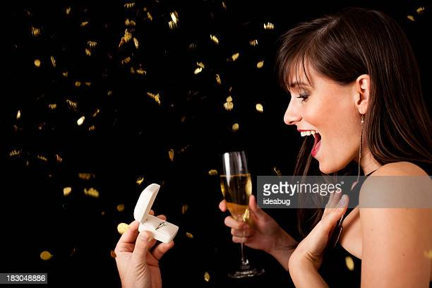 Happy Young Woman Excited by New Year's Proposal
