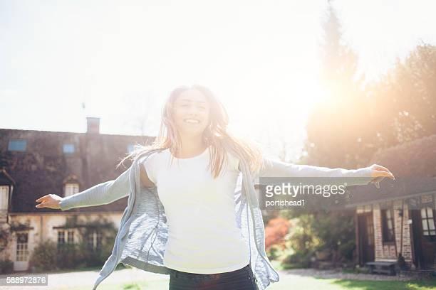 Happy young woman having fun outdoors