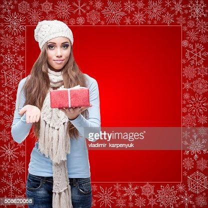 happy young woman holding gift over winter background : Stock Photo