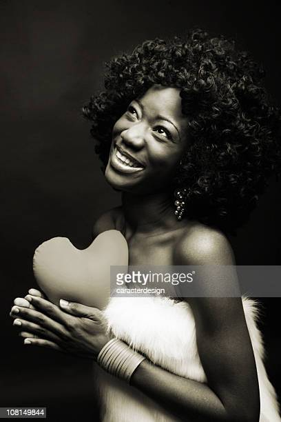 Happy Young Woman Holding Heart Pillow, Black and White