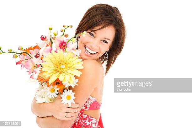 Happy Young Woman Hugging Flowers
