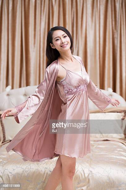 Happy young woman in bedroom