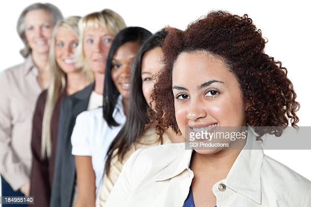 Happy young woman in front of diverse women line