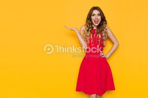 Happy Young Woman Is Holding Hand Raised, Presenting And Shouting : Stock Photo