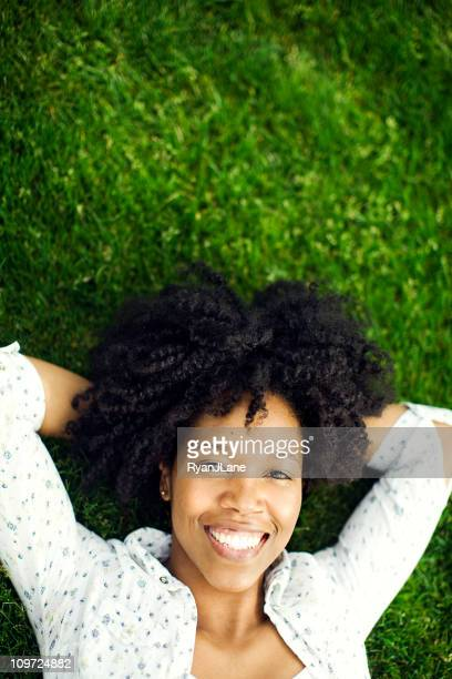 Happy Young Woman on Grass
