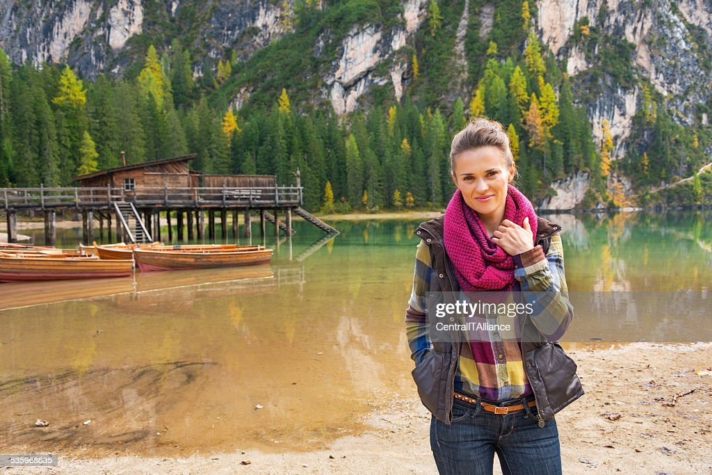 Happy young woman on lake braies in south tyrol, italy : Stock Photo