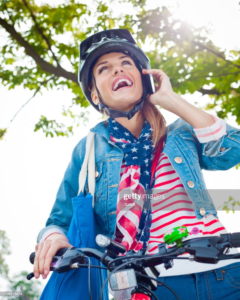 Happy young woman on phone : Stock Photo