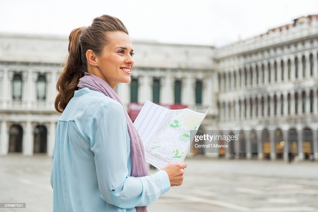 Happy young woman on piazza san marco in venice, italy : Stock Photo